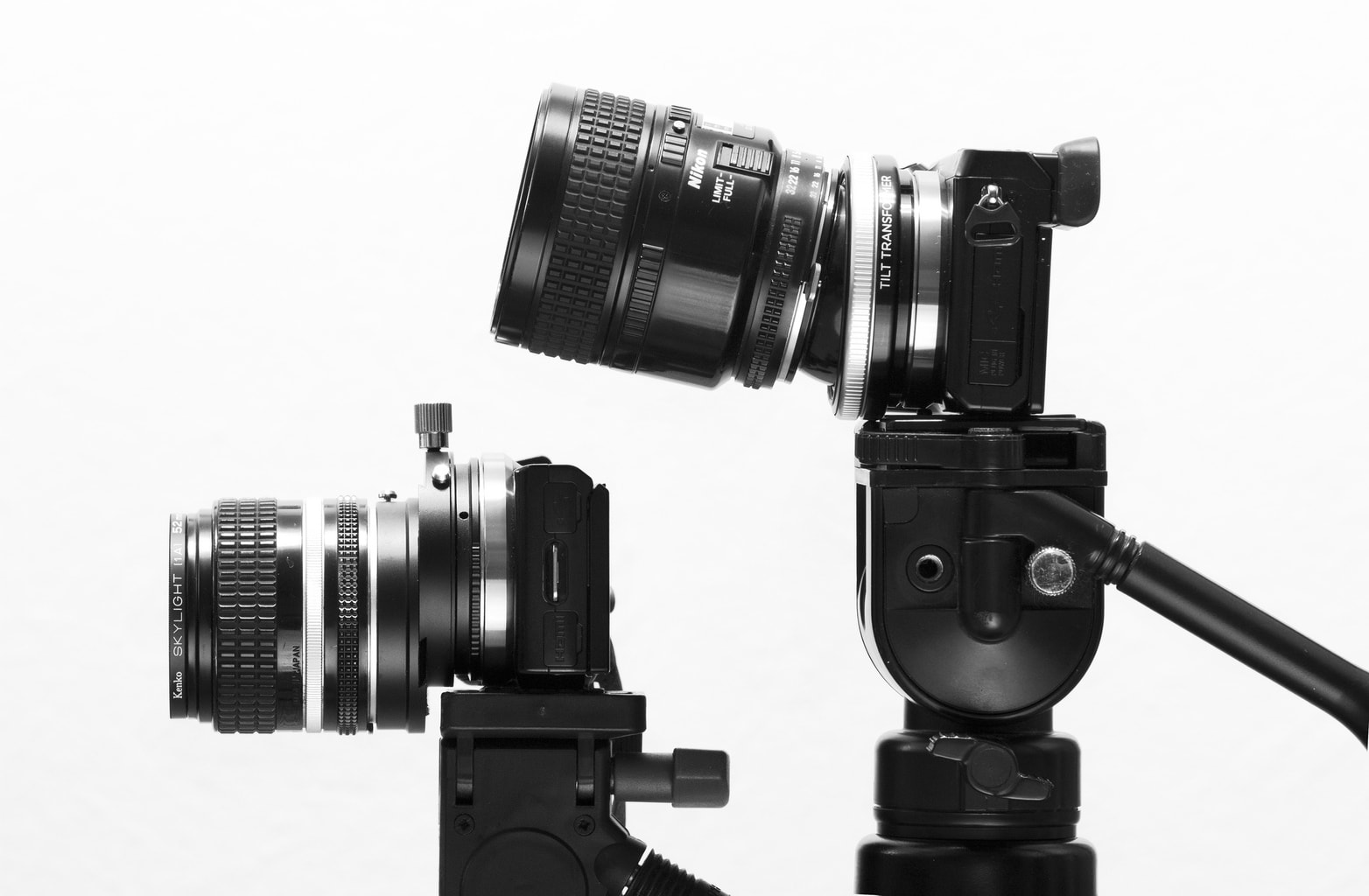 Ejemplo de dos objetivos descentrables Nikon y Keiko