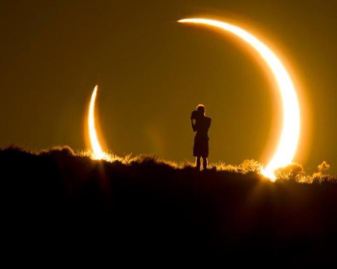 fotografía paisaje un chico observando un eclipse solar
