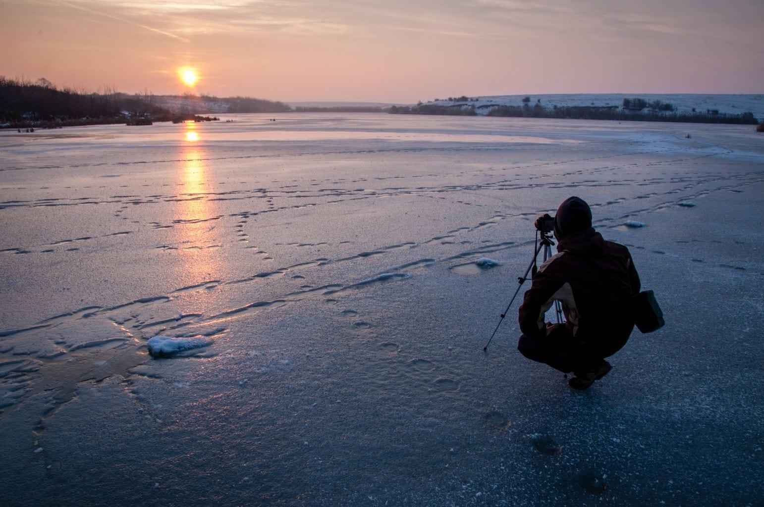 fotografía paisaje fotógrafo en un atardecer