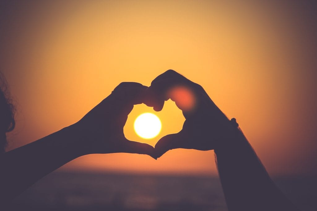 amor sol corazón