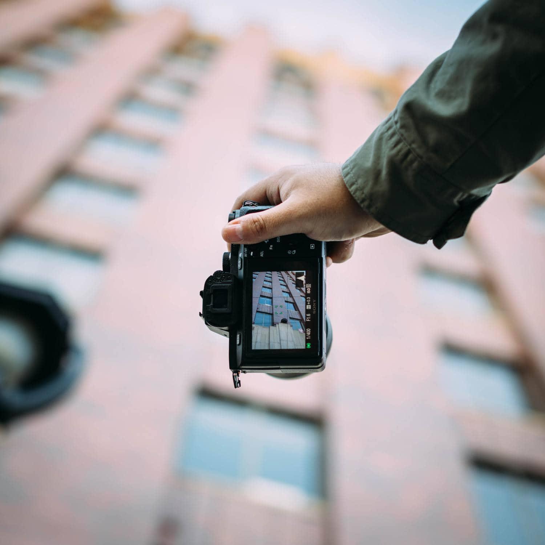 cámara mano fotógrafo